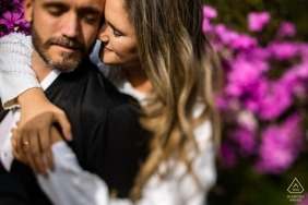 Engaged couple from Brazil pose for pre-wedding portrait in Garden with flowers