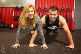 engagement photo at the gym working out | female and male, at fitness center