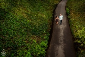 A NJ couple walk a narrow road during their pre-wedding portrait photo shoot