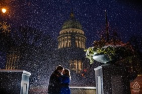 Engagement portrait during snowfall at Wisconsin State Capitol.