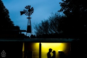 Lit engagement pictures of a couple silhouetted with windmill | Argentina photographer pre-wedding photo shoot session