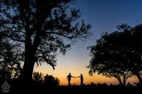 Santa Fe pre-wedding engagement pictures of a couple walking at sunset in the tall trees  | couple photography session