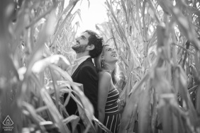 French Wedding Photographer Sylvain Bouzat captured this couple in a corn field during an Engagement Session In Lyon
