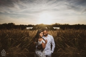 UK countryside engagement pictures of a couple in the grass fields  | Essex photographer pre-wedding shoot