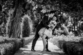 Dipping black and white pre-wedding engagement pictures of a couple having some fun | Romanian couple photography session