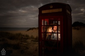 England engagement portraits of a couple in phone booth in the countryside  | UK photographer pre-wedding photographer pictures