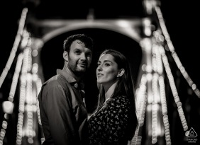 Dorset pre-wedding engagement pictures of a couple at night with lit bridge    couple photography session