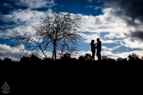 Madrid wedding engagement photography with a couple against blue sky with clouds | Spain photography