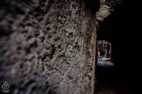 Hungary wedding photographer engagement portrait of a couple walking through carved caves  | Budapest pre-wedding pictures