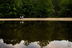 Lakeside engagement images of a couple reflected in the water | RI photographer pre-wedding session for portraits