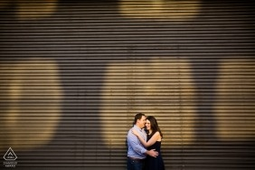 Sunlit engagement photos of a couple embraced | Rhode Island photographer pre-wedding portrait session
