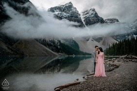 Canada wedding photographer engagement portrait of a couple in the mountains with a lake  | Alberta pre-wedding pictures