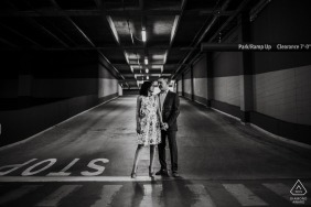 San Antonio black and white wedding photographer engagement portrait of a couple at the base of a parking structure exit ramp  | Texas pre-wedding pictures