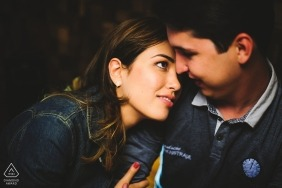 Indoor engagement photos of a couple caught in a love gaze | Brasilia photographer pre-wedding portrait session
