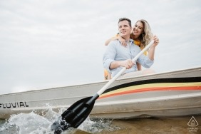 Nautical engagement images of a couple paddling small watercraft | Brazil photographer pre-wedding session for portraits