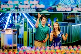 A Virginia couple during their pre-wedding portrait session at a carnival | Arlington, VA photographer