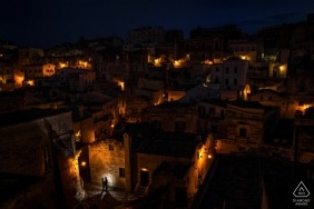 Reggio Calabria wedding engagement photography with a couple at night with the city glowing | Calabria photography