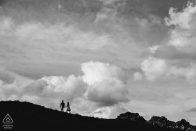 Northamptonshire engagement pictures of a couple silhouetted on a mountain walk under the clouds | United Kingdom photographer pre-wedding photo shoot session