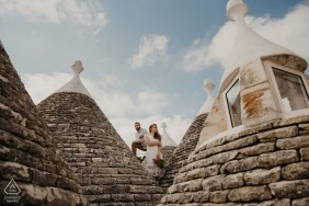 Bulgaria pre-wedding engagement pictures of a couple amidst stone structures  | Lovech portrait shoot