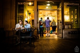 Engaged couple during portrait session at ice cream shop by Faneuil Hall in Boston | MA wedding and engagement photography