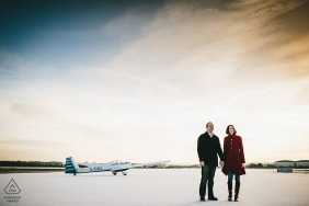 East Midlands engagement portraits of a couple at the airport with planes | Northamptonshire photographer pre-wedding photographer pictures