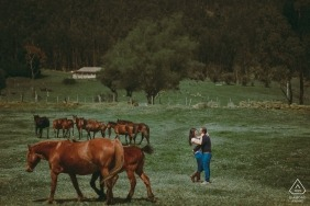 Pre-wedding portrait of a couple by a photographer in Colombia with Horses Sotaquirá