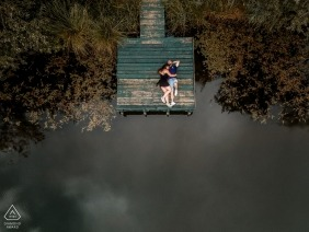 Overhead, drone portrait of couple on boat dock | Séance wedding engagement - France | S'aimer de haut