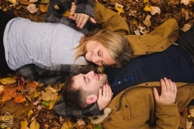 Engagement portrait with fall leaves in Quebec