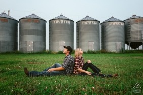 Wedding engagement photography before grain bins and silos in Alberta by Canada engagement photographers