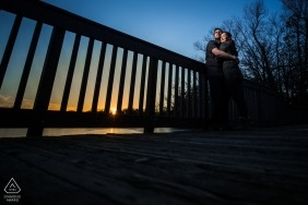 Minnesota wedding engagement pictures with a sunset on the bridge by Minneapolis photographer
