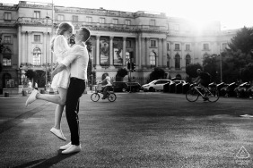 București pre wedding photography of a couple hugging in the sunlight by a building
