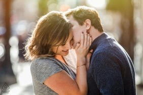 chicago Engagement Photo session with couple kissing in sunlight