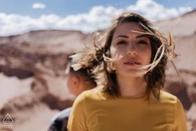 Atacama desert pre wedding portraits | The wind blowing this couple around