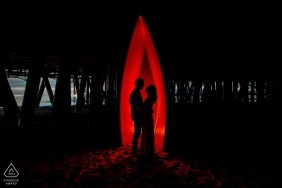 Red Silhouette Under Santa Monica Pier   California Engagement Portrait Photographer