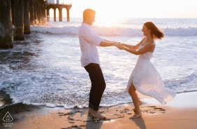 Los Angeles, CA | West coast love at the beach with a pier at sunset | Engagement Photographer