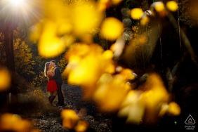 Kisses during their fall mountain engagement photos near Frisco Colorado