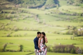 Peak District, Northamptonshire, United Kingdom engagement portraits above the grass fields and hills