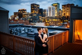 A portrait against the Denver Skyline for this engagement session in downtown Denver, CO