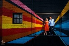 Denver, CO Pre-Wedding Portraits | A couple sharing a moment in front of a beautiful art mural in downtown Denver for their urban engagement session.