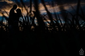 Merian, KS pre wedding portraits - Engaged couple at sunset at the place they'll build their first home
