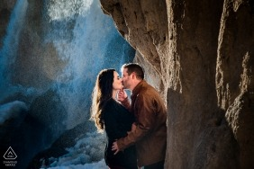 Rifle Falls Engagement | Colorado Wedding Photo Session | Bride and Groom kissing under waterfall