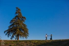 future bride leading future husband -  Follow Me to LA - Engagement Shoot
