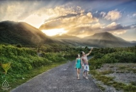 Taiwan Lanyu engage couple walk along a path before the setting sun for their pre-wedding portrait