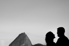 Rio de Janeiro engagement photo of couple silhouetted with mountain peak behind them