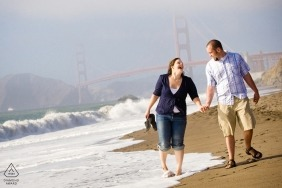 Couple walking on beach - SF Engagement Photographer