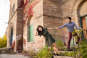Playful couple at abandoned building - Wisconsin Engagement Session
