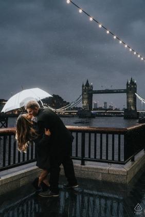 Tower Bridge, London England | Couple kissing in the rain near tower bridge