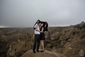 cappadocia engagement photo shooting in the rain outside