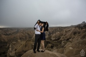 cappadocia engagement photo shooting in the rain outside