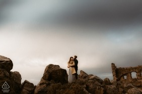 Arthur's Seat, Edinburgh pre-wedding portraits - posing for photos Amongst the ruins.